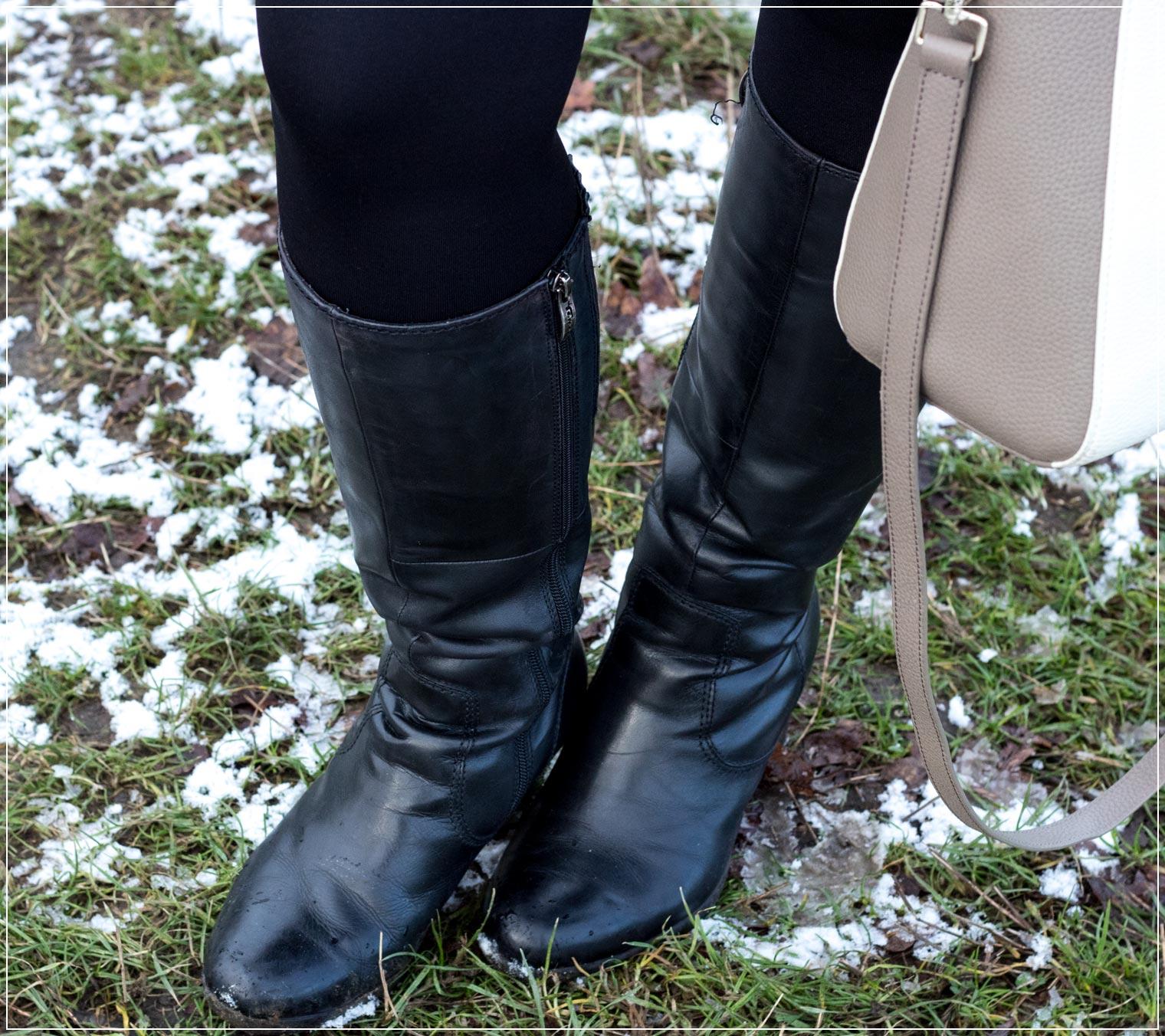 schwarzes Lederstiefel zum eleganten Winteroutfit