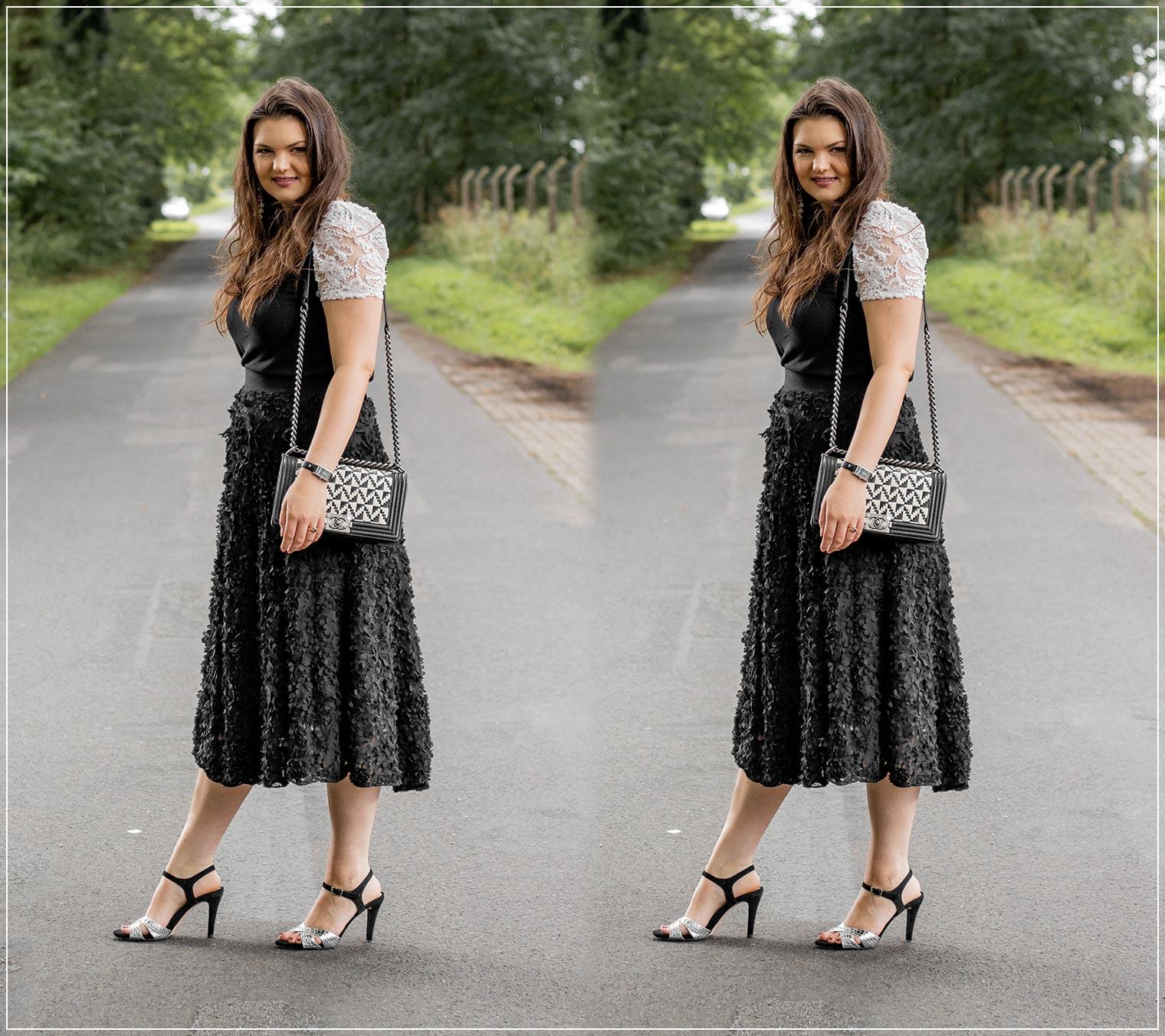 eleganter Look mit Midi-Rock im Black and White Style zur liebsten Handtasche